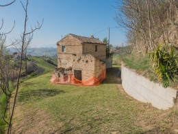 FARMHOUSE TO RENOVATE FOR SALE IN MONTEFIORE DELL'ASO in the Marche in Italy